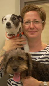 Megan Ores-Uhrich CPDT-KA with two of her rescue dogs