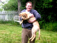 Man holding Yellow Lab